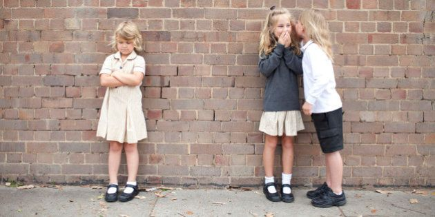 Bullying and whispering school kids in