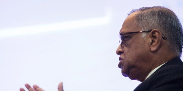 N.R. Narayana Murthy, co-founder and chairman of Infosys Ltd., gestures as he speaks during the Hong...