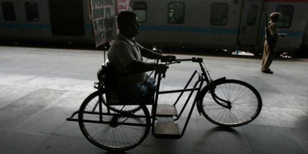 A physically disabled man takes part in a protest rally at a railway station on the outskirts of the...