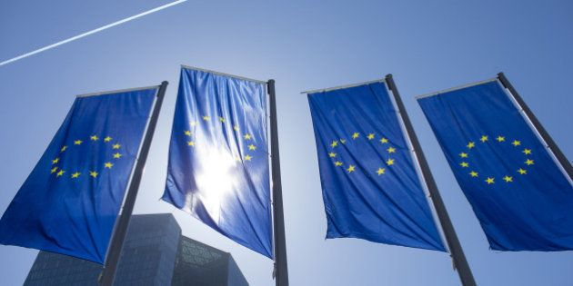 The stars of the European Union (EU) sit on banners flying outside the European Central Bank (ECB) headquarters...