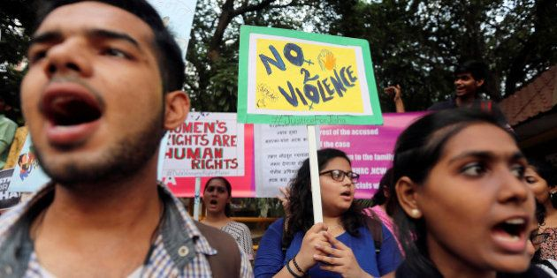 Demonstrators shout slogans during a protest against the rape and murder of a law student in the southern...