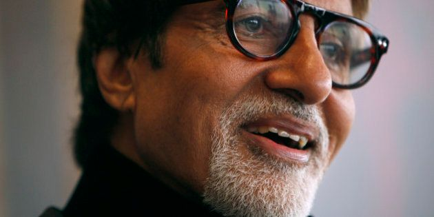 Indian actor Amitabh Bachchan reacts during the Asian Film Awards news conference in Hong Kong March...