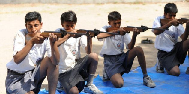 Volunteers of Bajrang Dal participate in the air rifle training session at a youth camp on the outskirts...