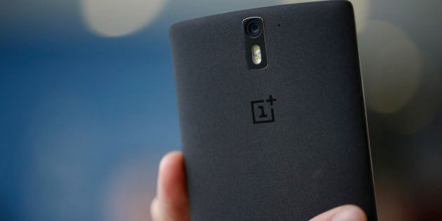 A 1+ logo sits on the case of a OnePlus One smartphone in this arranged photograph at the Mobile World...