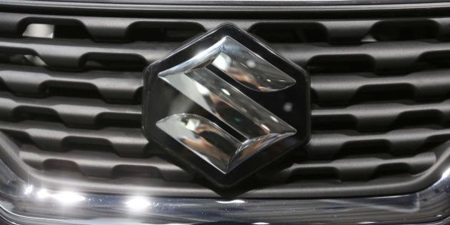 The Suzuki badge sits on the grill of a Suzuki Baleno automobile, produced by Suzuki Motor Corp., at...