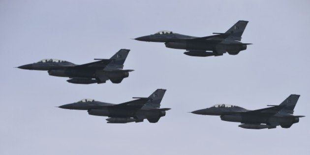 Pakistani F-16 fighter jets fly past during the Pakistan Day military parade in Islamabad on March 23,...