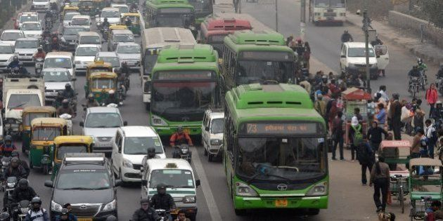 Indian commuters board Delhi Transport Corporation (DTC) buses in New Delhi on January 15, 2016. New...