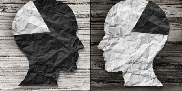Ethnic equality concept and racial justice symbol as a black and white crumpled paper shaped as a human...