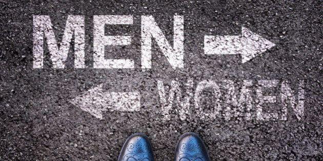 Feet and words men and women painted on an alphalt