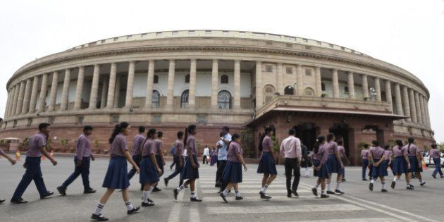 NEW DELHI, INDIA - MAY 3: School students arrive at Parliament House during the Parliament Session on...