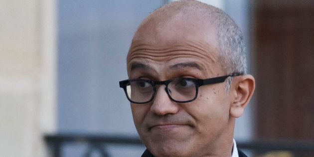 Microsoft CEO Satya Nadella looks back to the media as he leaves the Elysee Palace after a meeting with...