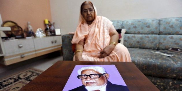Zakia Jafri shows a photograph of her late husband Ehsan Jafri, a lawmaker for the Congress party which...
