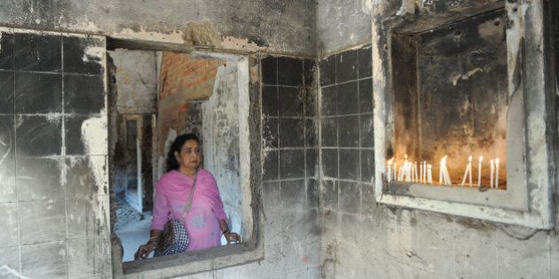 Suraiya Ankleshwaria looks on as she and others pay homage to those killed at Gulbarg Society following...