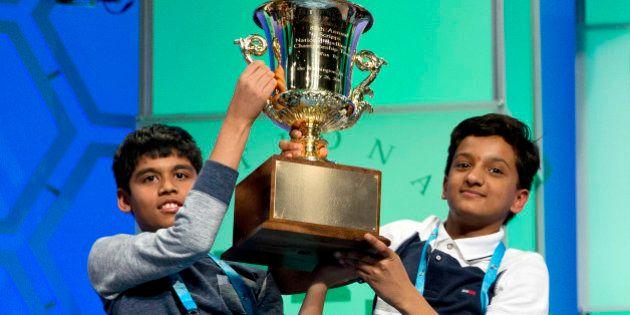 Nihar Janga, 11, of Austin, Texas, and Jairam Hathwar, 13, of Painted Post, N.Y., hold up the trophy...
