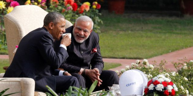 U.S. President Barack Obama and India's Prime Minister Narendra Modi (R) talk as they have coffee and...