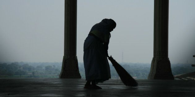 This is a photograph of a lone sweeper cleaning the floors of Agra Fort. Who knows what she is thinking...