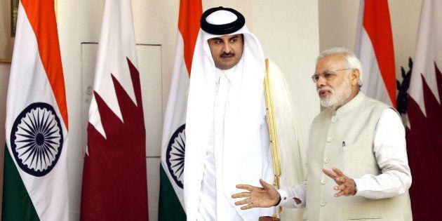 NEW DELHI, INDIA - MARCH 25: Emir of the State of Qatar Sheikh Tamim bin Hamad Al-Thani in conversatio...