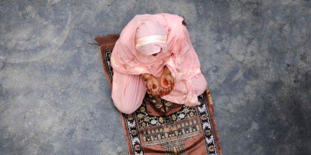 DADRI, INDIA - NOVEMBER 10: A Muslim woman pray in her home at Bisada village on November 10, 2015 in...