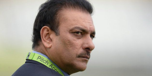 India's director of cricket Ravi Shastri looks on before the third one-day international cricket match...