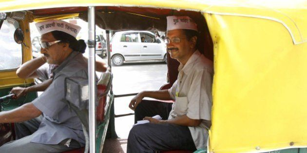 NEW DELHI, INDIA - JUNE 10: Aam Aadmi Party leader Arvind Kejriwal taking ride on Auto rickshaws during...