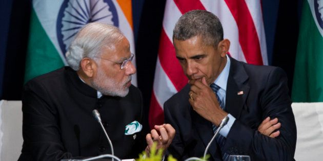 U.S. President Barack Obama, right, meets with Indian Prime Minister Narendra Modi during the COP21,...