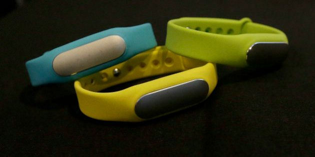 Xiaomi Mi Bands are displayed at a presentation in San Francisco, Thursday, Feb. 12, 2015. While stopping...