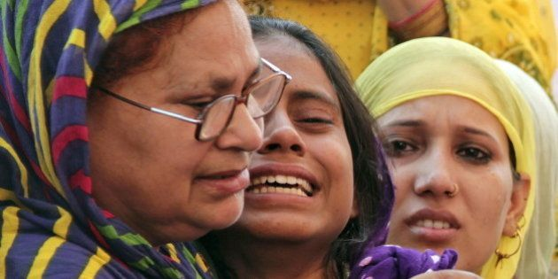 Relatives of Mohammad Akhlaq mourn after he was killed by a mob on Monday night, at his residence in...