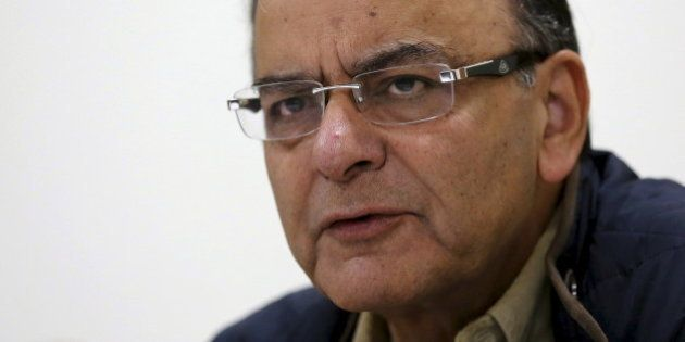 India's Finance Minister Arun Jaitley speaks with the media in New Delhi November 23, 2015. India will sell shares in some state-run companies when market conditions improve, Jaitley said on Monday, as the government struggles to meet its asset sales target that is crucial to help plug its deficit. REUTERS/Adnan Abidi