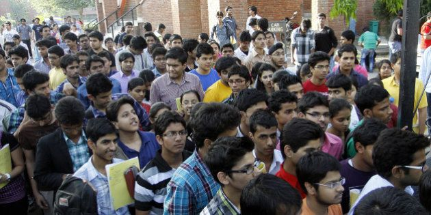 NEW DELHI, INDIA - APRIL 8: Students walk out of the examination center after appearing for IIT JEE 2012...