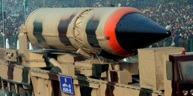 India's nuclear-capable Agni III missile rolls past during the final full dress rehearsal for the Indian...