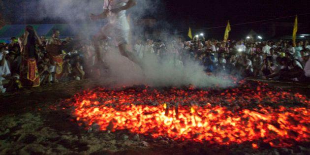 A Spirit medium walks across burning coals at the Phuket Vegetarian Festival in Phuket Town, Thailand....