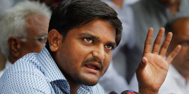Hardik Patel, center, 22-year-old firebrand leader of Patidar Andolan Samiti addresses a press conference...