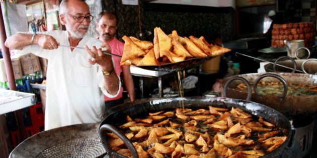 Frying mutton samosa in Bangalore during