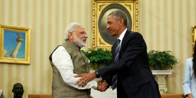 U.S. President Barack Obama (R) shakes hands with India's Prime Minister Narendra Modi after their remarks...