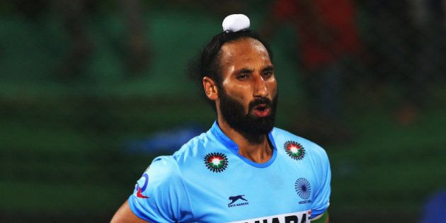 RAIPUR, INDIA - DECEMBER 06: Sardar Singh captain of India celebrates scoring during the penalty shoot...