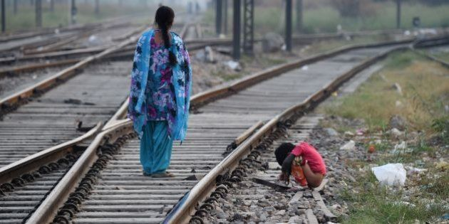 An Indian child defecates in an open near a railway track on International Toilet Day in New Delhi on...