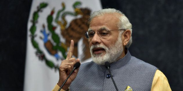 Indian Prime Minister Narendra Modi (L) delivers his press message at the Los Pinos presidential Palace...