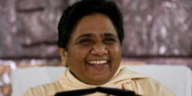 India's Bahujan Samaj Party (BSP) chief Mayawati smiles as she addresses journalists at a press conference...
