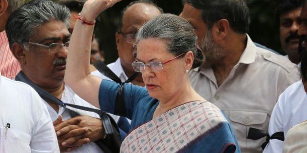 India's opposition Congress party president Sonia Gandhi, centre, leads other Congress party lawmakers...