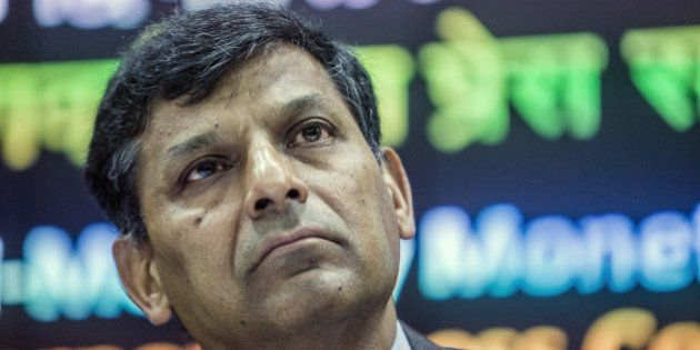 Raghuram Rajan, governor of the Reserve Bank of India (RBI), listens during a news conference in Mumbai,...