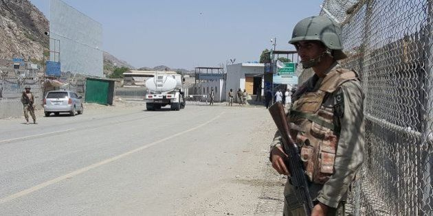 Pakistani soldiers patrol at the Torkham crossing between Pakistan and Afghanistan in Pakistan's Khyber...