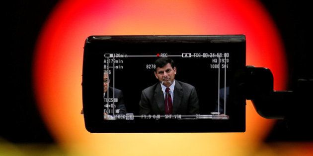 Reserve Bank of India (RBI) Governor Raghuram Rajan is seen in a TV camera's viewfinder as he attends...