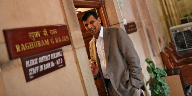 FILE PHOTO: India's chief economic adviser Raghuram Rajan stands outside his room at the finance ministry...