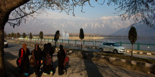 SRINAGAR, KASHMIR, INDIA - FEBRUARY 18: Kashmiri Muslim girls wearing abaya, a long tunic and veil, the...