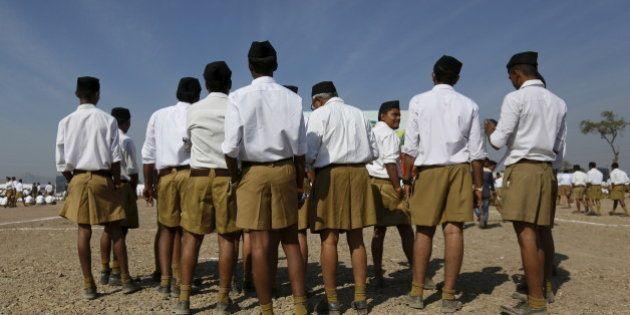 Volunteers of the Hindu nationalist organisation Rashtriya Swayamsevak Sangh (RSS) arrive to attend a...