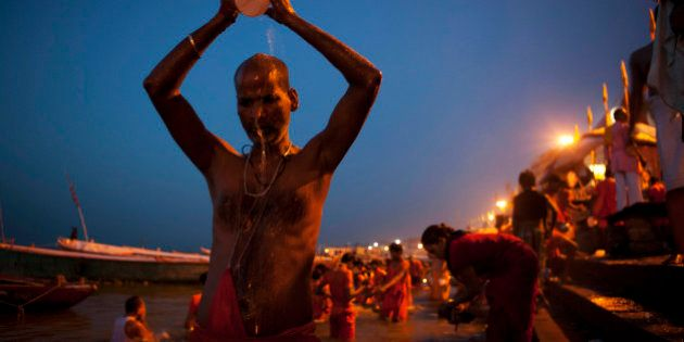 Hindu devotees bathe early morning at the River Ganges in Varanasi, India, Wednesday, July 11, 2012....