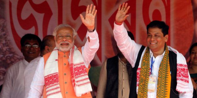 India's main opposition Bharatiya Janata Party (BJP) prime ministerial candidate Narendra Modi, left,...