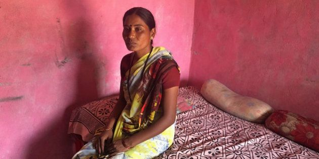 Joshna Wandile, a widow, poses inside her two-room house in Alipur village in the western state of Maharashtra,...