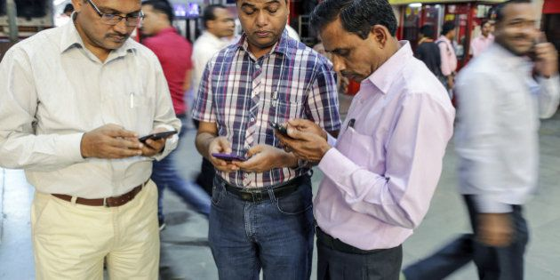 Passengers use smartphones at Mumbai Central railway station in Mumbai, India, on Friday, Jan. 22, 2016....