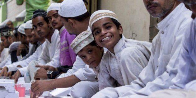 VARANASI, UTTAR PRADESH, INDIA - 2015/07/09: People of different beliefs organised Iftar party on 21st...